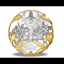 // színarannyal díszített ezüstözött érem, Szent László legendája a Szent Koronával  // A Szent Korona dicsőségét hirdeti az 1295-ös legenda is, hogy a tatárokkal szemben a székely sereget a koronát viselő Szent László égi jelenése vezette harcba.